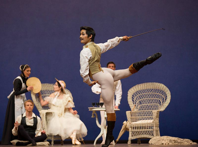 "6. Young Gyu Choi (Gaston Rieux), in the background: Nadia Yanowsky (Nanina, Marguerite's chambermaid), Marijn Rademaker (Armand Duval) and Igone de Jongh (Marguerite Gautier), ""Lady of the Camellias"" by John Neumeier, Dutch National Ballet 2015"